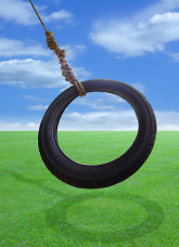 http://www.dreamstime.com/royalty-free-stock-photo-tire-swing-swings-freely-sunny-field-image41192645